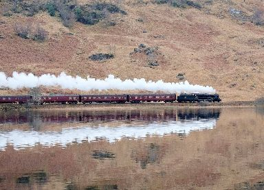 The famous 'Harry Potter train' travels alongside Loch Eilt near Glenfinnan.