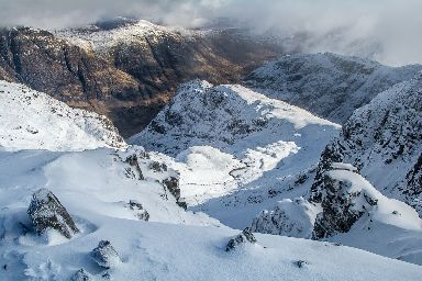 Looking down on the snowy Three Sisters at Glen Coe.