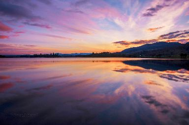Watercolour skies overlook the Lake of Menteith at the Carse of Stirling.