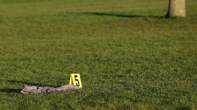 Police marked several items of clothing on the grass near to the site where the body was found.