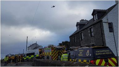 Rescue: A coastguard helicopter was scrambled to the scene.