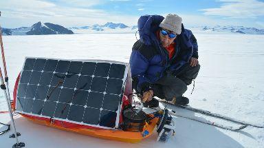 Barney Swan using a solar panels