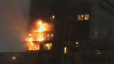 Fire crews tackled the blaze which broke out at an apartment building in central Manchester.