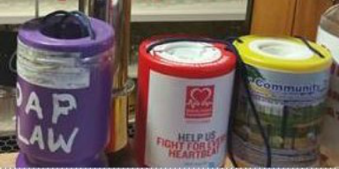 Charity tins: Three of the five that were taken in 'despicable' act.