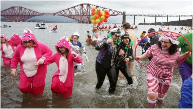 Swim: More than 1,000 took part in the annual Loony Dook.