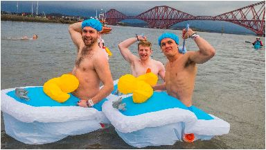 Swim: This brave trio brought their scrubbing brushes along.