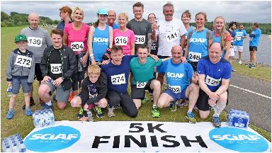Charity: Deacon Blue star Ricky Ross took part in the inaugural SCIAF fun run last summer.