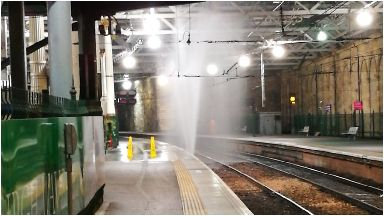 Rail: Water from the burst pipe sprayed high into the station roof.