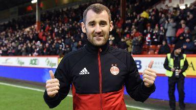 Niall McGinn returns for his second spell at Aberdeen.