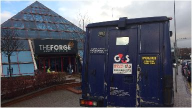 Raid: The G4S van remained at the scene on Wednesday morning.