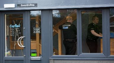 Officers were seen inside the restaurant on Tuesday.