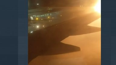 The wing of the Westjet plane caught fire after being clipped by another aircraft.