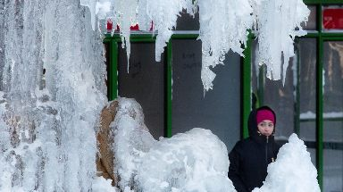 A woman passes a frozen fountain in New York's Bryant Park.
