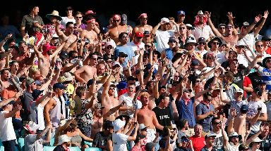 The crowd enjoy themselves in the heat at the Sydney Cricket Ground during the Fifth Ashes Test.