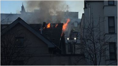 Fire: Flames could be seen coming from the roof of the building.