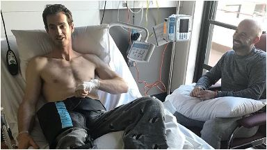 Recovering: Murray in hospital with coach Jamie Delgado.