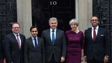 Brandon Lewis and Theresa May outside 10 Downing Street.
