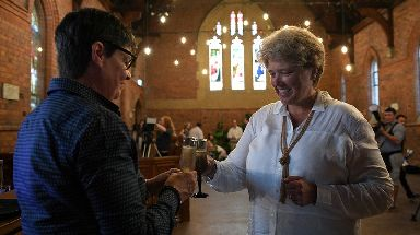 Felicity Evers (left) and Jenny Thompson share a toast after being married in a ceremony in Newcastle, Tuesday, January 9, 2018.