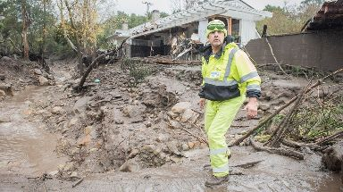 Cesar Limon of the Montecito Water Dristrict surveys the area of Montecito Creek.