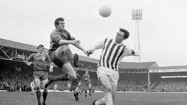 Keeper: Tommy Lawrence, left, races to beat West Brom's Jeff Astle to the ball in a sixth round FA Cup tie.