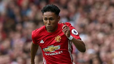 Manchester United defender Demetri Mitchell has joined Hearts on loan.