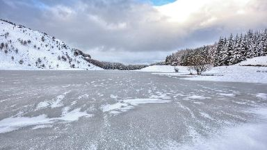 A completely frozen over Loch na Creige by Aberfeldy.