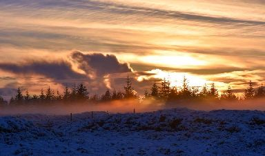 A misty sunset out on the moors.