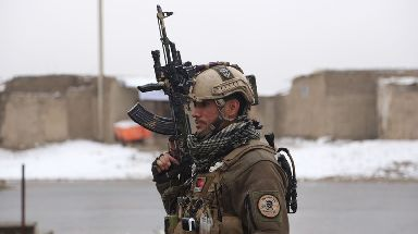 A member of Afghan security personnel arrives at the attack site.