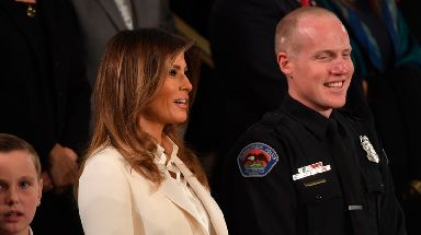 First Lady Melania Trump and Albuquerque policeman Ryan Holet.