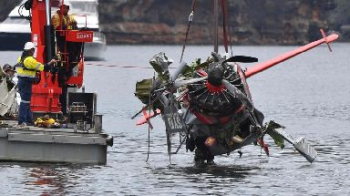 Authorities recover the wreckage of the seaplane.