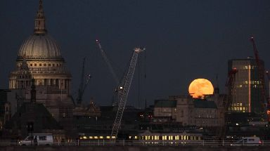 A super moon rises over the City of London.