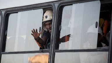 A worker from the Beatrix mine returns to safety.
