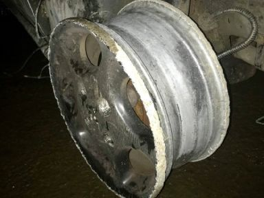 The car was being driven on public roads without any tyres
