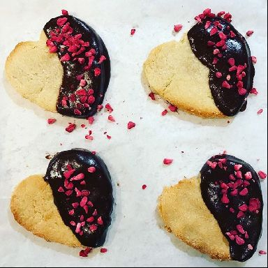 Almond cookies with dark cocoa and raspberries.