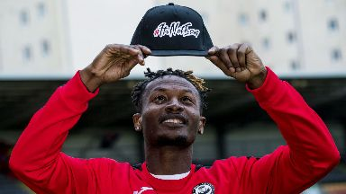Abdul Osman showed off his fashion range at Firhill yesterday.