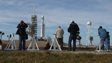 Photographers set up remote cameras ahead of the launch.