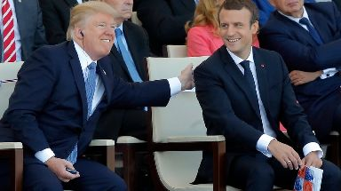 French President Emmanuel Macron and Trump attending the Bastille Day military parade.