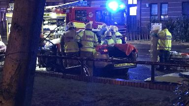 Crash: Firefighters cut officer free.