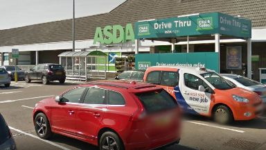Asda: Man taken to hospital.