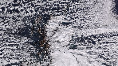 Arctic blast: Snow and clouds swirl over Scotland.
