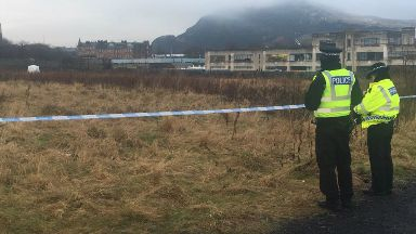 Investigation: Parts of field sealed off.