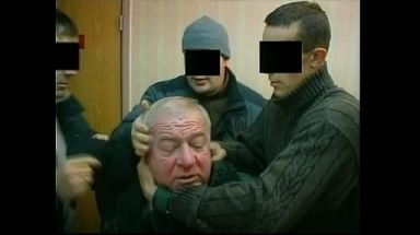 Mr Skripal being arrested by Russian security personnel.
