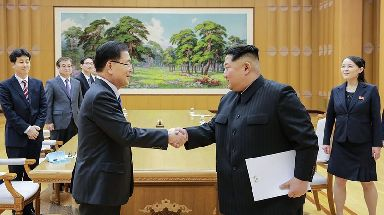 North Korean leader Kim Jong Un shakes hand with South Korean National Security Director Chung Eui-yong, in Pyongyang.