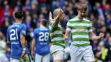 Scott Brown and Kris Ajer celebrate Celtic's equaliser.