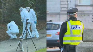Police: Forensic officers at the scene of the crime.