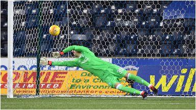Freddie Woodman saves Eamonn Brophy's penalty.