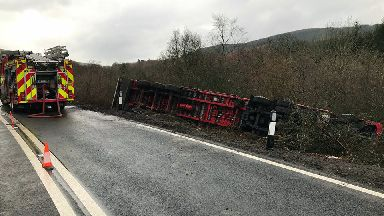 Lorry crash: HGV overturned at side of road.