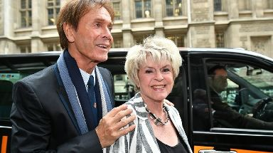 Sir Cliff with television presenter Gloria Hunniford at the Rolls Building in London to give evidence.