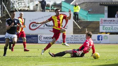 Partick Thistle forward Kris Doolan scores the goal that keeps the Jags up.