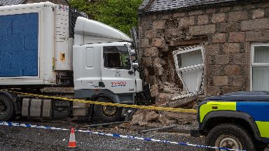 Crash: The Tesco lorry crashed into the house.